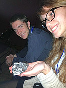 Students examine a meteorite at SpaceVision 2012.