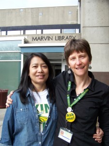 Student Aye Aye Tun and Library Senior Clerk Polly Karis, who has worked to help acclimate refugees to the college campus.