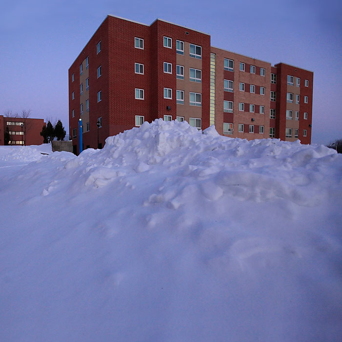 SUNY Oneonta - Higgins Hall in the winter snow