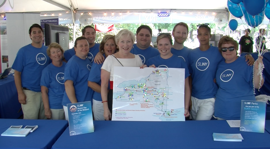 SUNY Chancellor Zimpher with group at 2012 New York State Fair