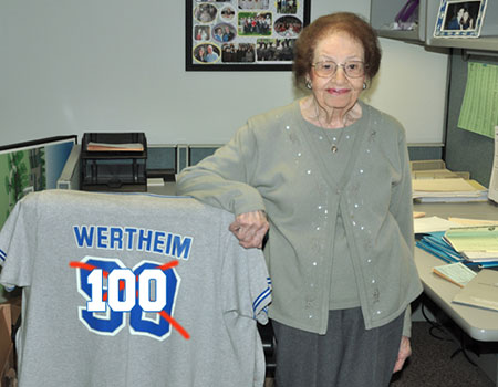 Mollie Wertheim of SUNYIT with a jersey signifying her 100 year birthday