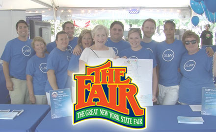 SUNY staff at the 2012 NY State Fair table