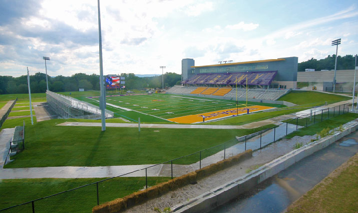 UAlbany new football field stadium endzone view with overhead sunlight