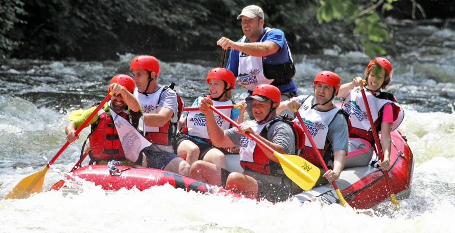 the Team SUNY raft navigating the rapids at the Governor Cuomo Adirondack Challege