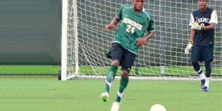 Herkimer County CC soccer player in front of goal