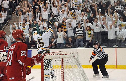Oswego hockey player celebrates goal against Plattsburgh