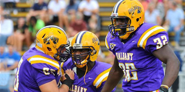UAlbany football players on the field