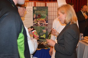 U.S. Sen. Kirsten Gillibrand checks out some of the products made by Morrisville State students during New York State Farm Day. The college showcased an array of food samples during the  annual event which boasts New York State agricultural products. Photo by Corey Hayes
