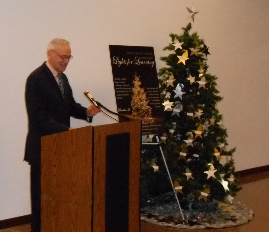 SUNY Sullivan's Vice President for Academic & Student Affairs addresses the students, faculty, administration and community members gathered at last year's Lights for Learning Tree Lighting Ceremony outside of the college's Kaplan Student Union.