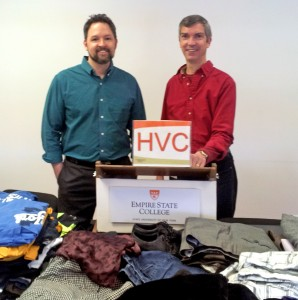 Two Empire State College Hudson Valley Center employees stand behind donations