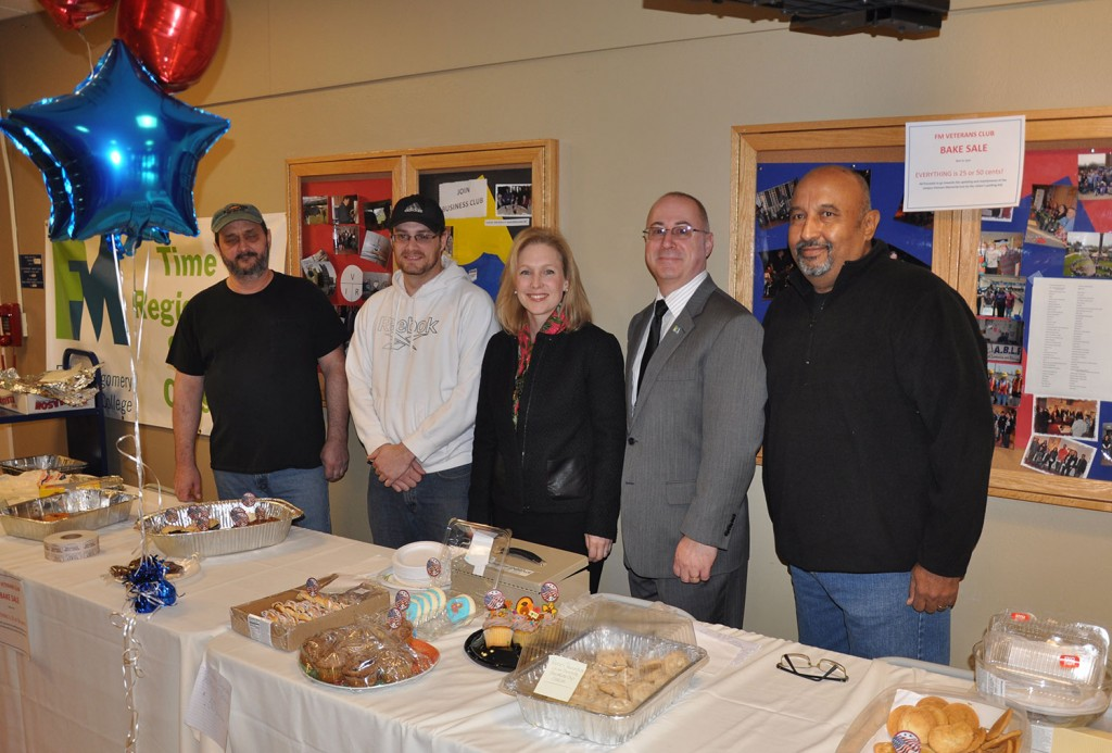 Veteran Club members Lloyd Roseboom, Wayne VanNostrand, College President Dr. Dustin Swanger, and Veteran Club president Charles DelToro stand with Senator Kirsten Gillibrand at a Veteran's Bake Sale