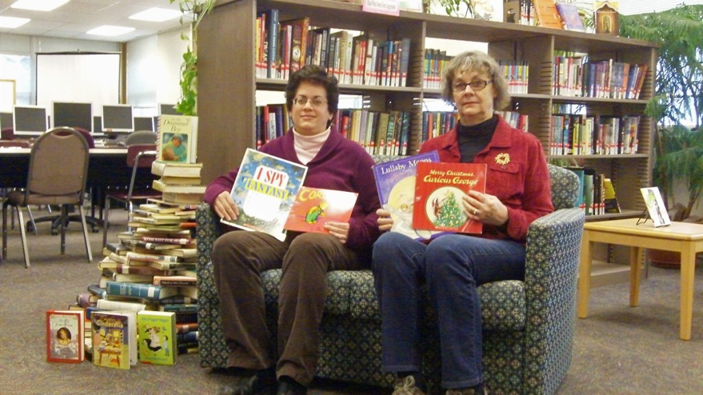 Jefferson Community College female staff members with books gathered form the holiday book drive