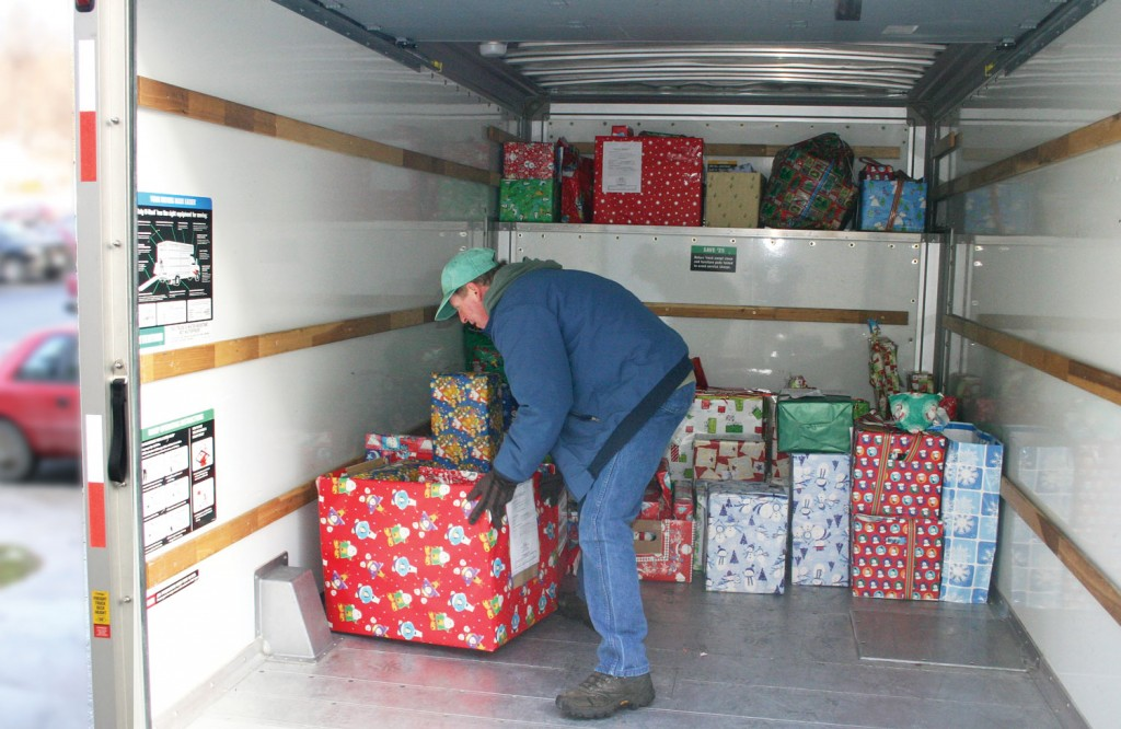 SUNY Orange County Community College Volunteer inside truck with gift boxes