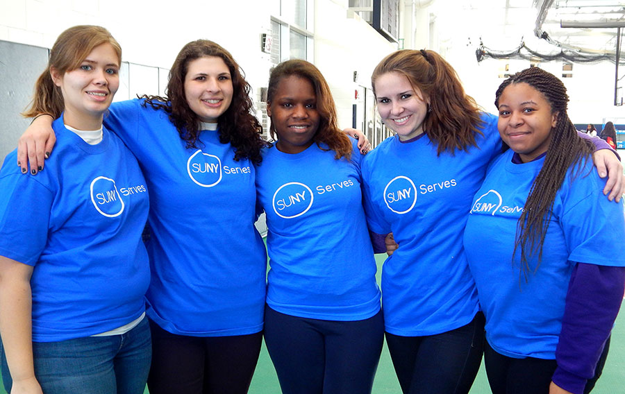 female students from Canton with SUNY Serves shirts at Martin Luther King Jr Day of Service 2014