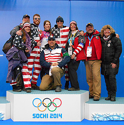 Erin Hamlin '11, center, is surrounded by friends and family, including her brothers Ryan and Sean and parents Eileen and Ron. Kneeling is Hamlin's coach, USA Luge Program Director and Two-time Olympic medalist Mark Grimmette.