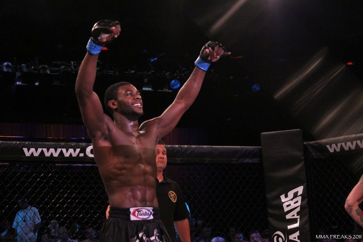 Aljamain Sterling stands with raised hands  in the octagon at Cage Fury Fighting Championships 10 in July 2011