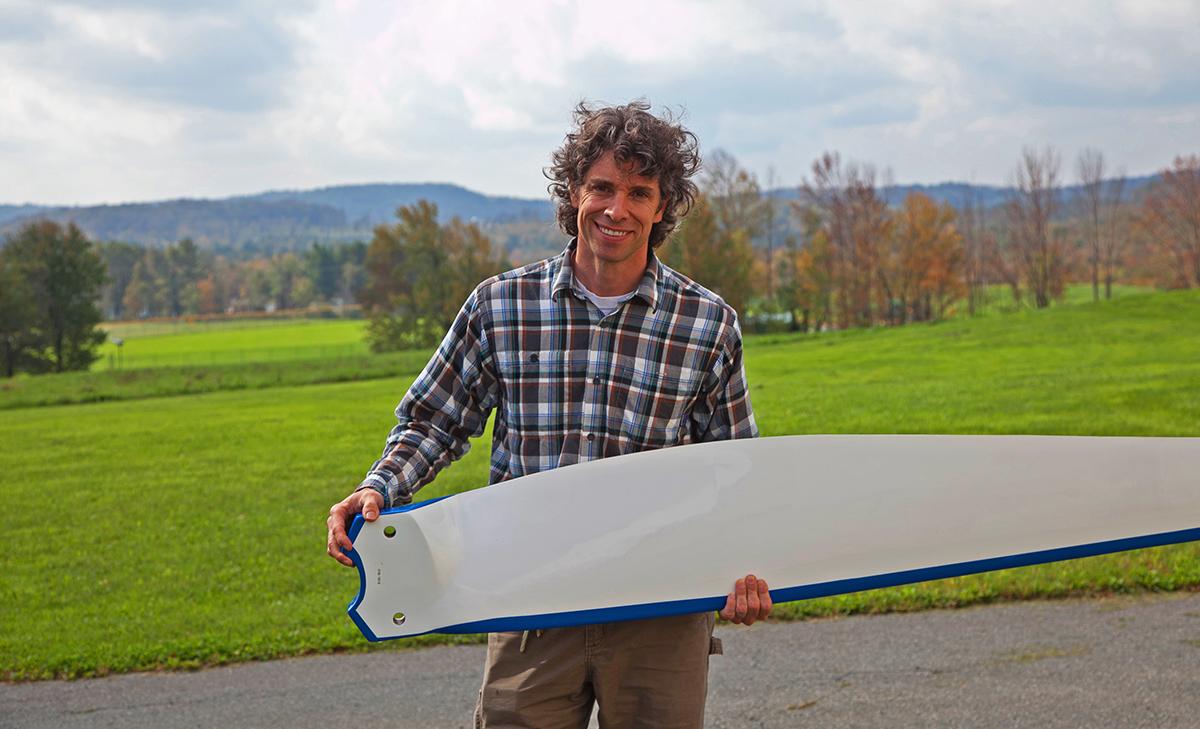 Man holds SUNY Sullivan Energy Efficient Wind Turbine blade