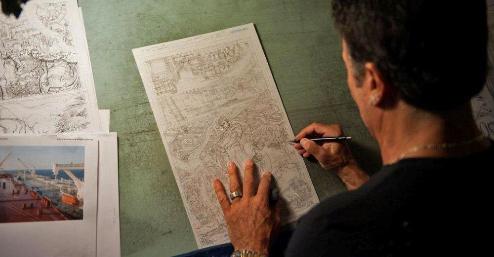 John Romita Jr sketching comics in his office.
