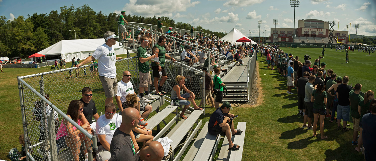 Fans pack the bleachers at SUNY Cortland to watch NY Jets training camp.