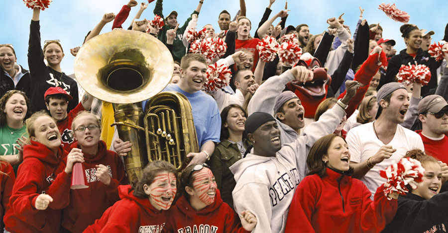 Oneonta fans cheer at the game with the school band.