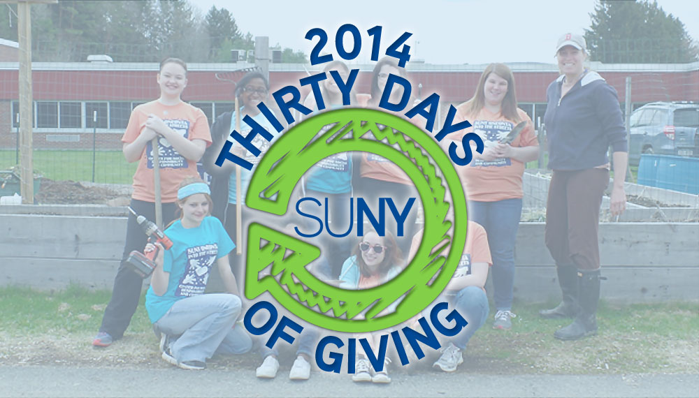30 Days of Giving 2014 with students from oneonta doing building and cleanup.