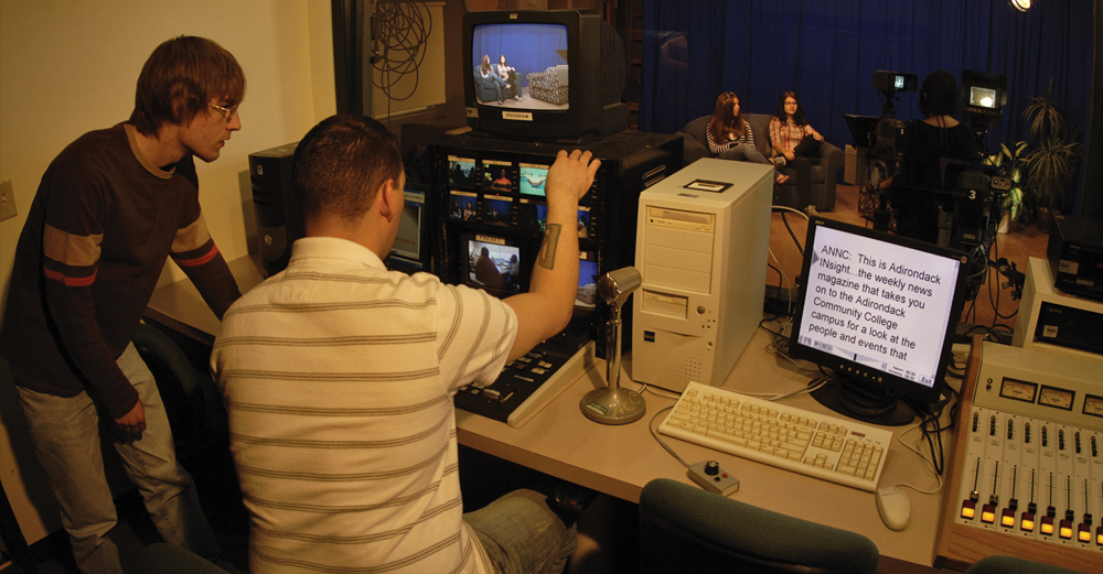 SUNY Adirondack students behind a camera and video board producing a campus television show.