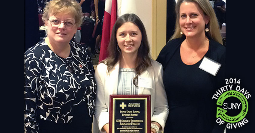 3 ladies from SUNY ESF stand with American Red Cross Outstanding Sponsor Award plaque.