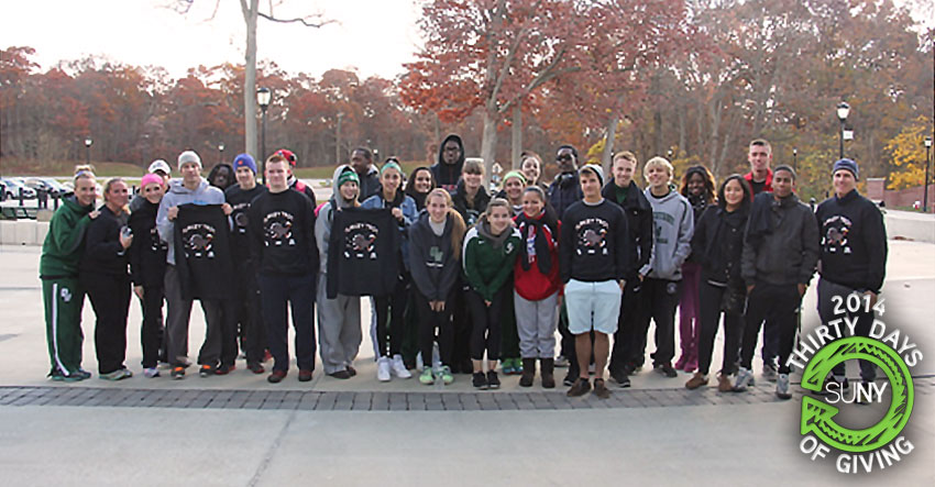 Students, faculty, and staff from SUNY Old Westbury pose for a picture after their Turkey Trot and Food Drive event.