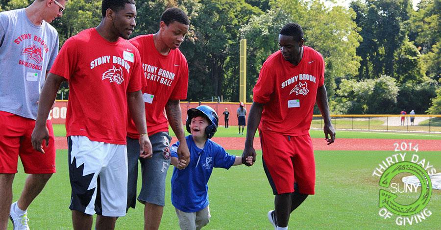Stony Brook University athletes at the Miracle on Long Island baseball event.