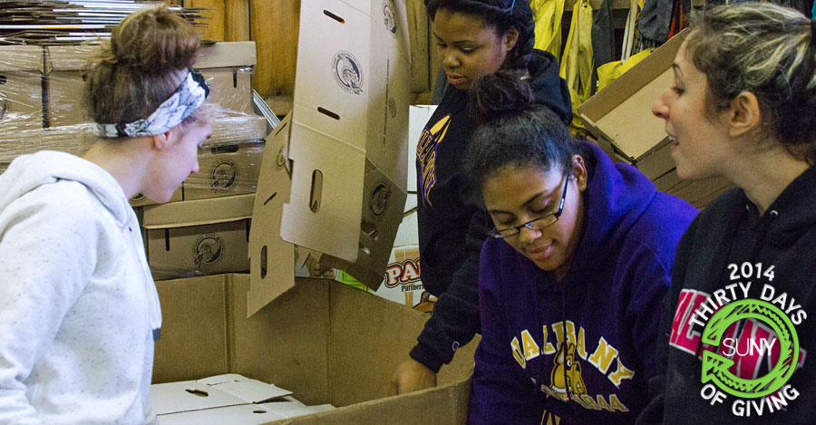 University at Albany students volunteer at the Regional Food Bank of Northeastern New York.