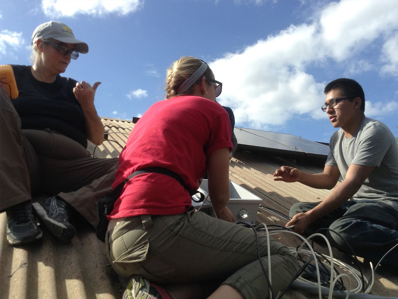 SUNY Broome students install solar panels on a roof in Haiti