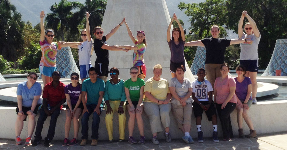 SUNY Broome students form the word Haiti with the arms during the Health for Haiti trip