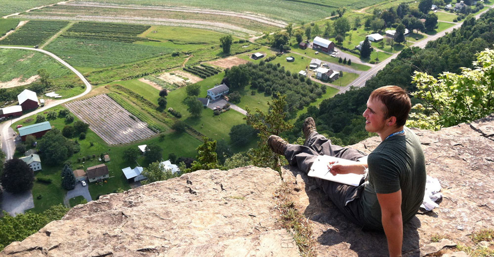Freshman Mike Barr checks out the view from Vroman's Nose in Schoharie County on the first day of GEOFYRST, a six-day geology camping trip for new students.