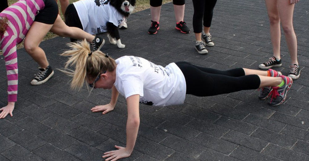 One student does push-ups while partaking in a charity fundraiser.