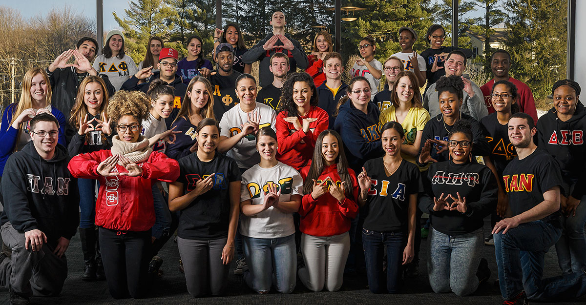 Various members of Greek Life organizations pose outdoors at SUNY New Paltz.