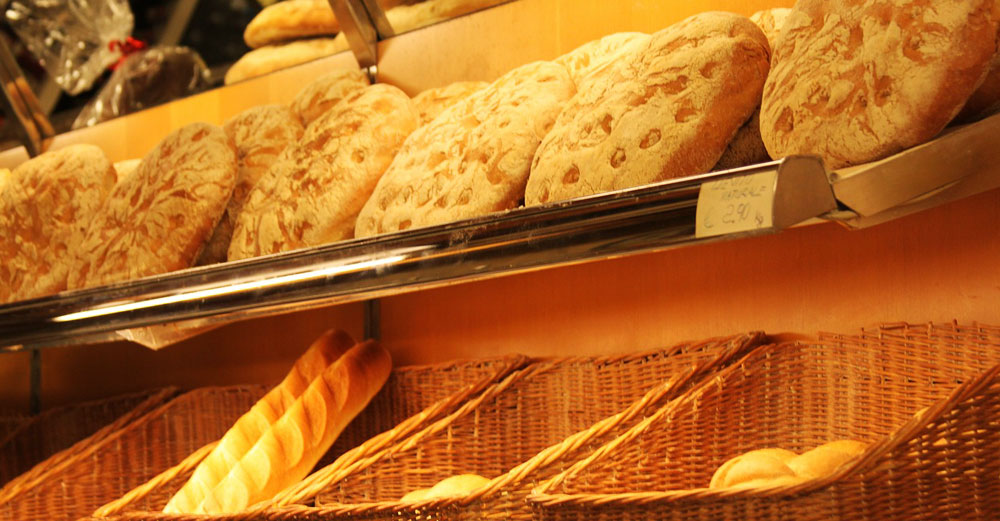 Bread baskets on bakery shelves