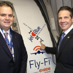 Governor Cuomo posses with JetBlue CEO Robin Hayes before boarding a plane to Cuba.