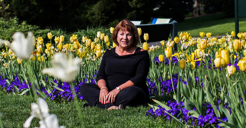 Elizabeth Mazes sits in the grass at the New York Botanical Garden in the Bronx.  Photo courtesy Christopher Gregory for The New York Times.