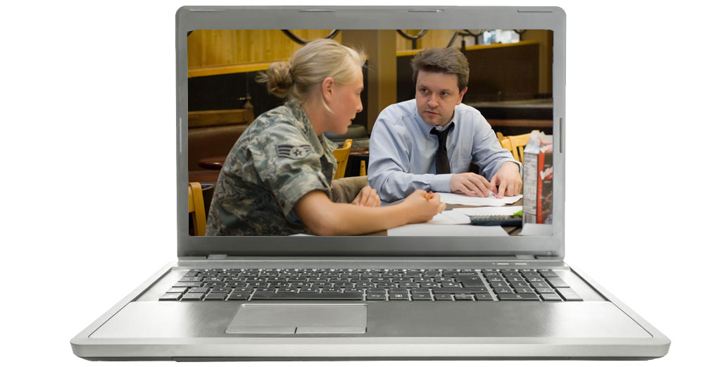 Monroe Community College laptop with teacher sstudent at table inside it.