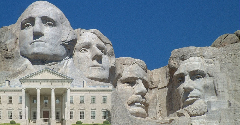 Mount Rushmore monument with a picture of the White House near it.
