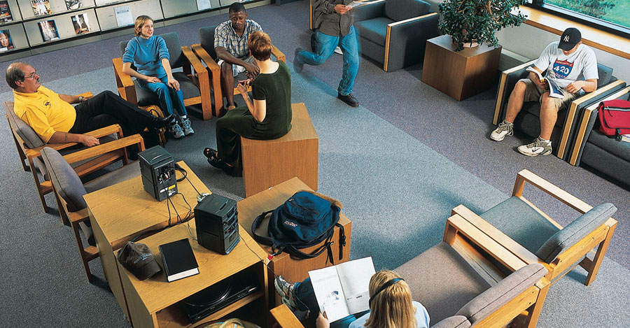 Finger Lakes Community College students in library chairs from overhead.