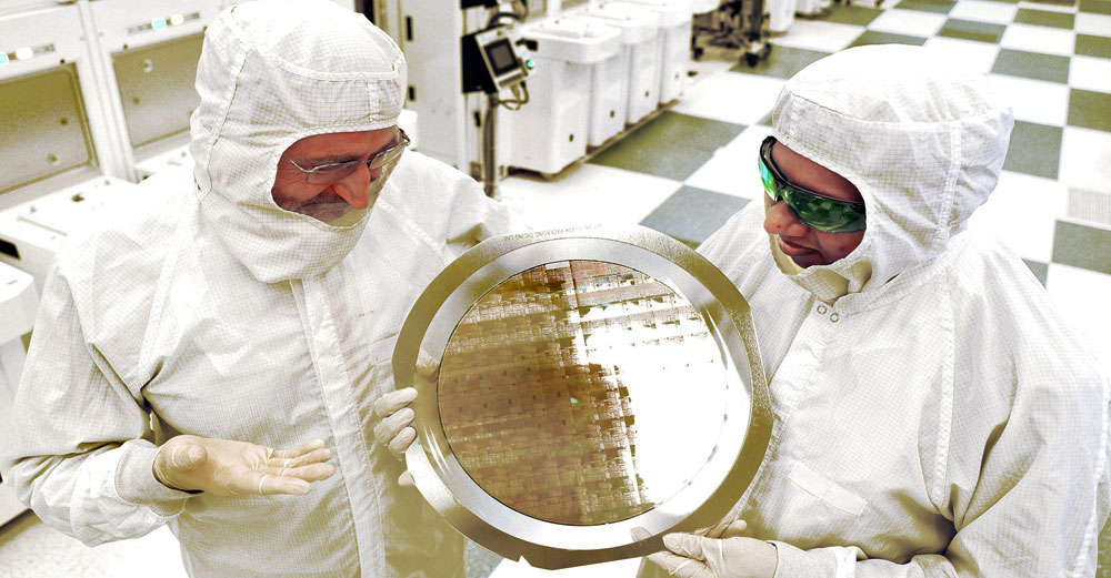 2 scientisits at SUNY Poly hold 7nm wafers on display. Photo courtesy Darryl Bautista/FPS FOR IBM
