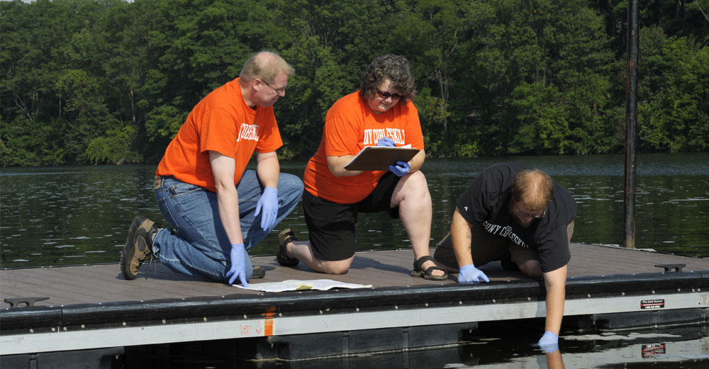 Cobleskill professors take part in water sample study in the Mohawk River.