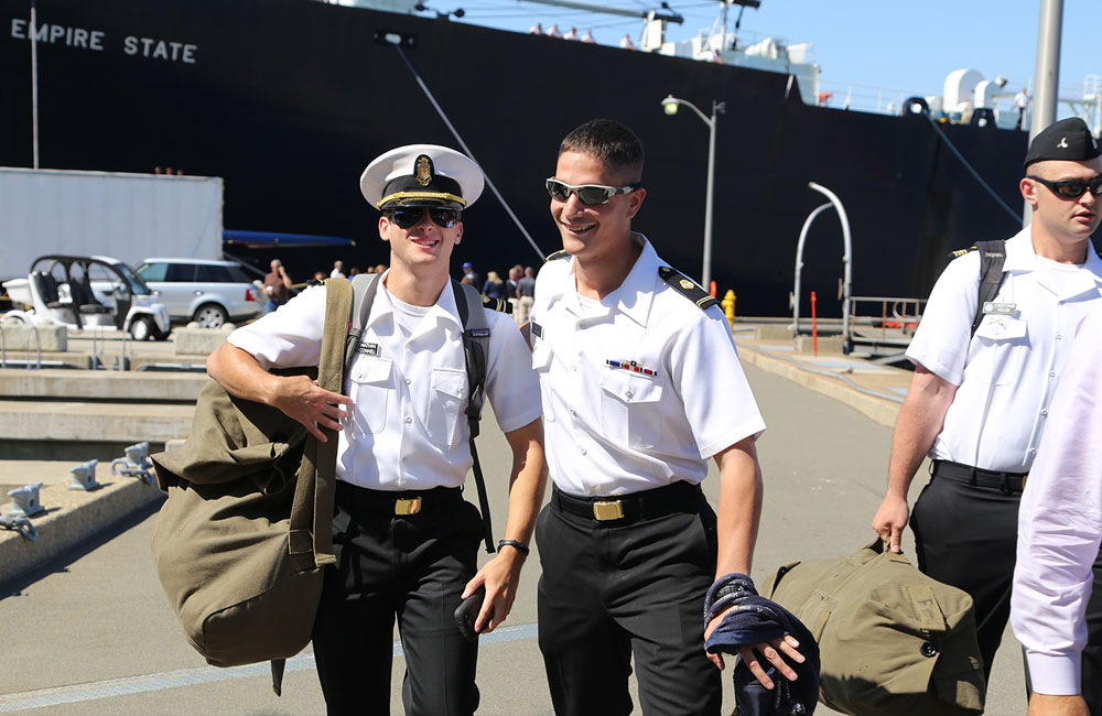 2 Maritime cadets step off the Empire State VI ship after their semester at sea.