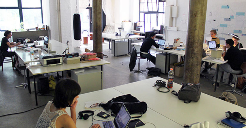 Employees in a shared open workspace.