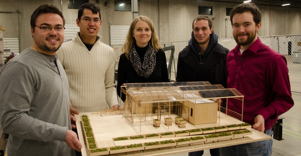 UBuffalo students stand with model of their sustainable, solar GRoW Home.