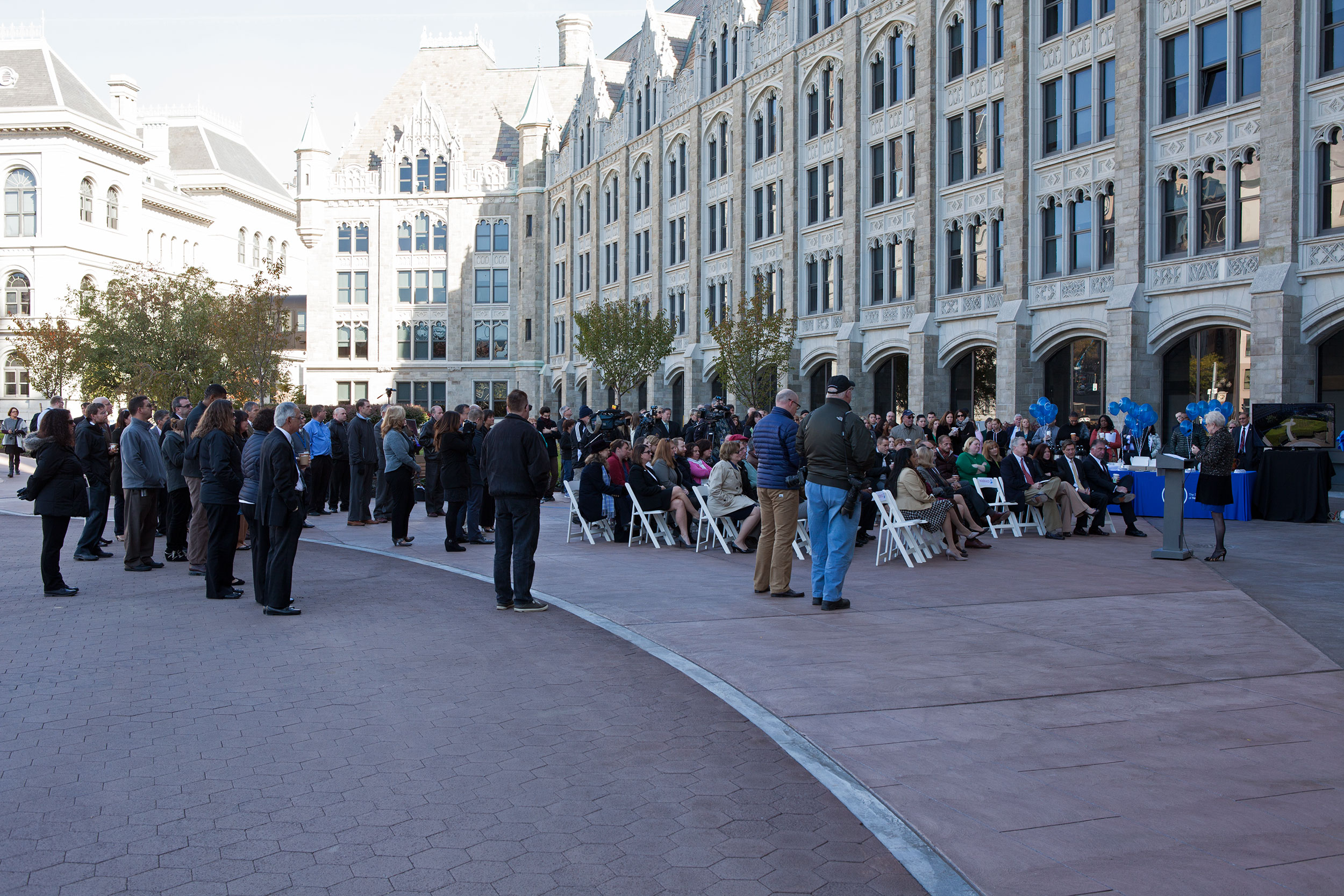 A crowd sits and listens to Chancellor Zimpher speak before the ribbon cutting of the SUNY System Administration Plaza renovations in Albany.