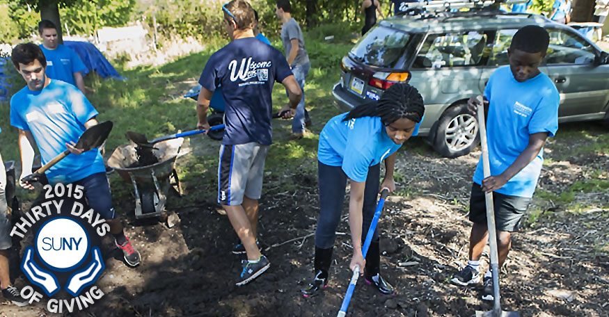 Binghamtonn University Students with shovels cleaning up outdoor park space.