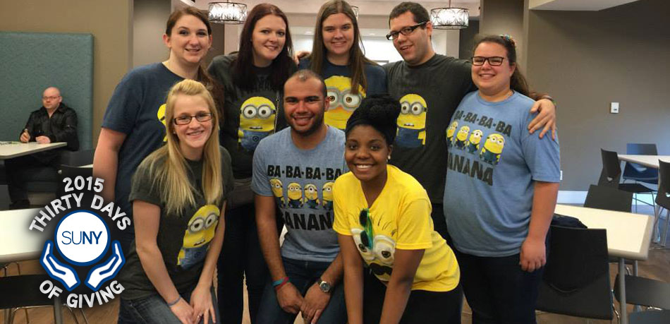 Students from Niagara County Community College pose in Minions tshirts in classroom.