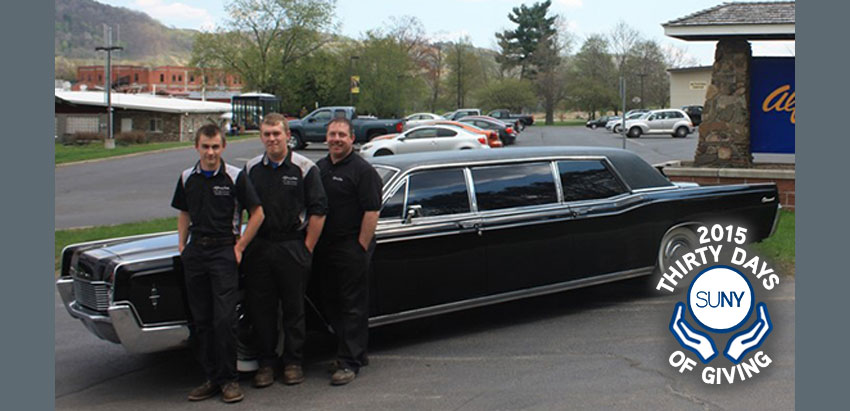 2 students at Alfred State stand with limousine provider in front of a limousine before ELK charity challenge.
